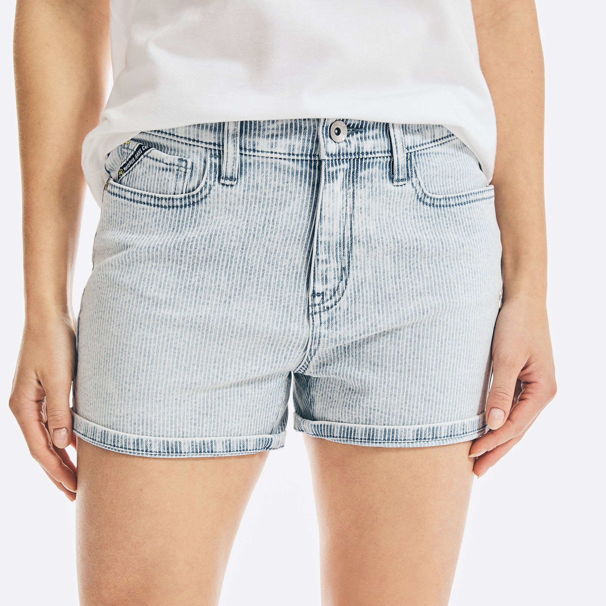 model wearing a light wash pair of shorts