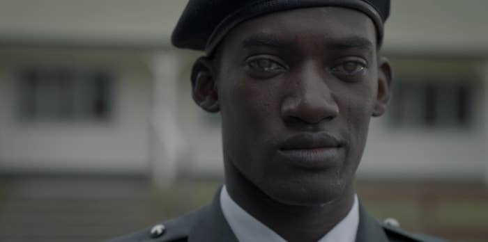 man wearing army outfit is crying