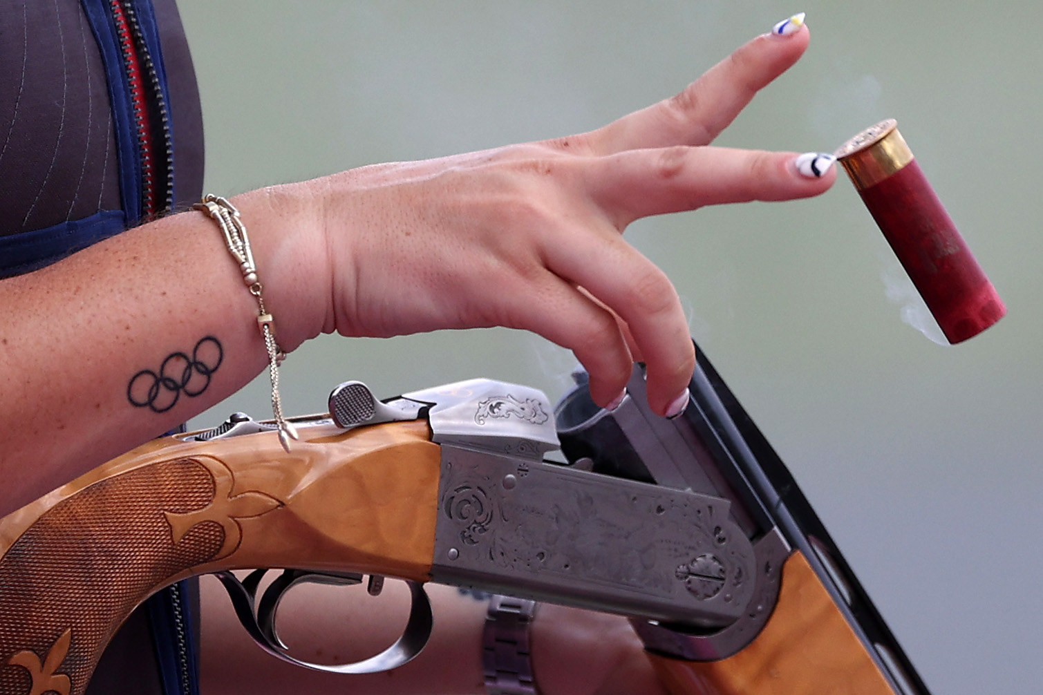 A female Olympian holds a gun at the Tokyo Olympics