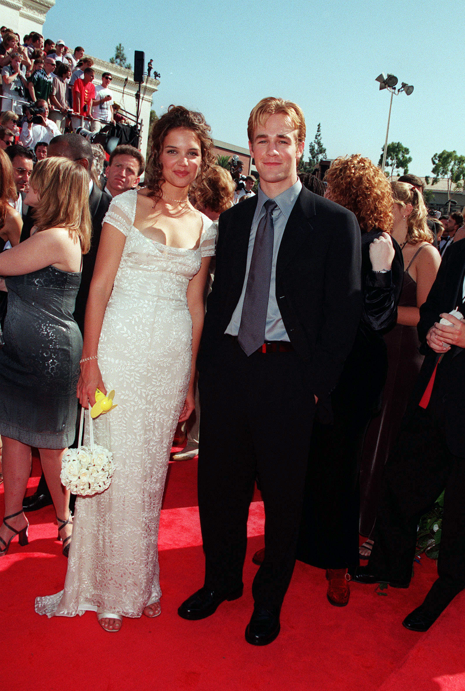 Katie Holmes and James Van Der Beek are pictured at an event in 1998