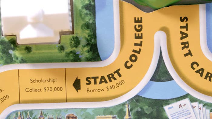 Life boardgame with square that says start college, borrow $40,000