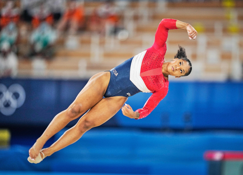 Jordan Chiles flies in the air diagonally during the artistic gymnastics final
