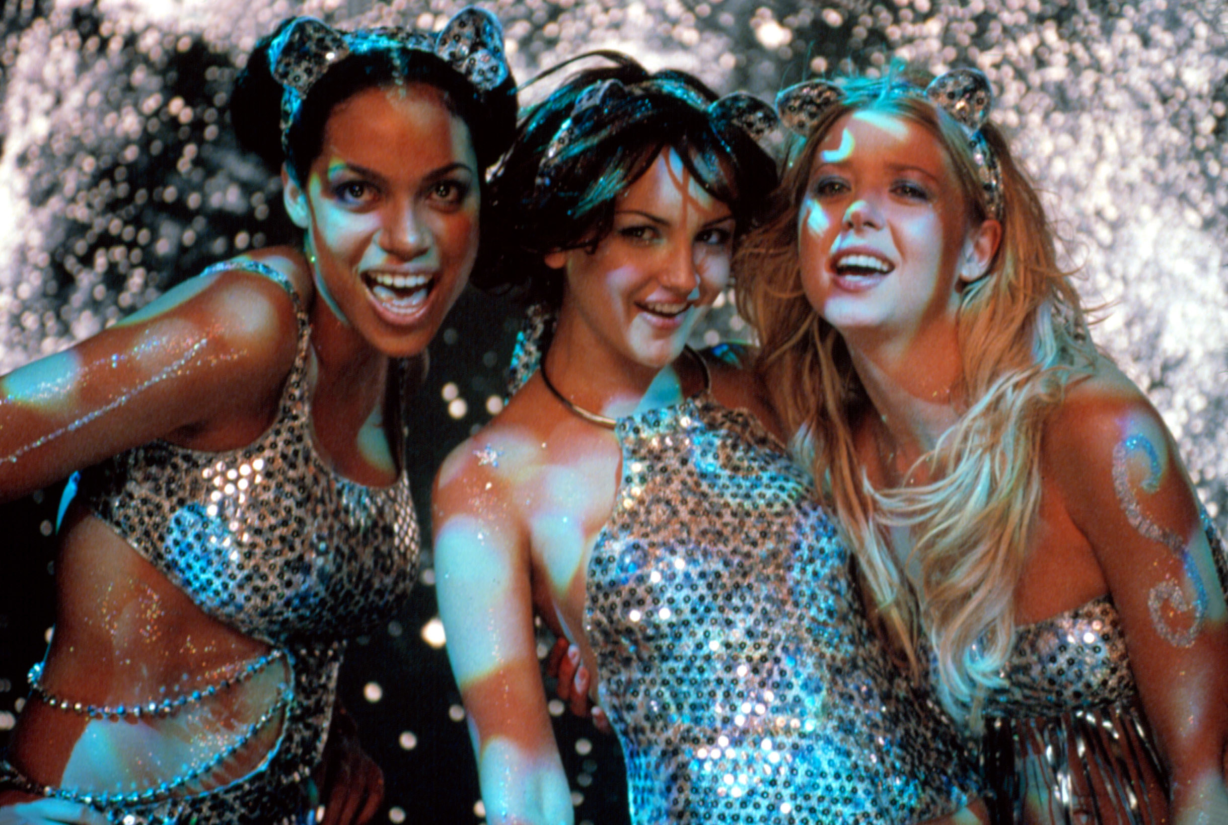 Rosario Dawson,Rachael Leigh Cook, and Tara Reid smile while wearing cat ears as Valerie, Josie, and Melody