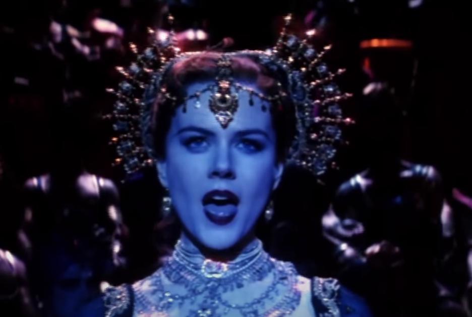 Nicole Kidman sings while wearing a bejeweled headdress asSatine