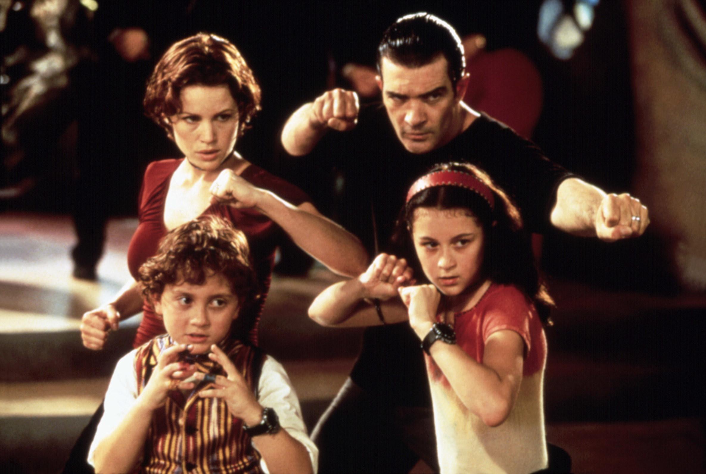 Carla Gugino,Antonio Banderas,Daryl Sabara, and Alexa Vega put their hands in fists, ready to fight as Ingrid,Gregorio, Juni, and Carmen