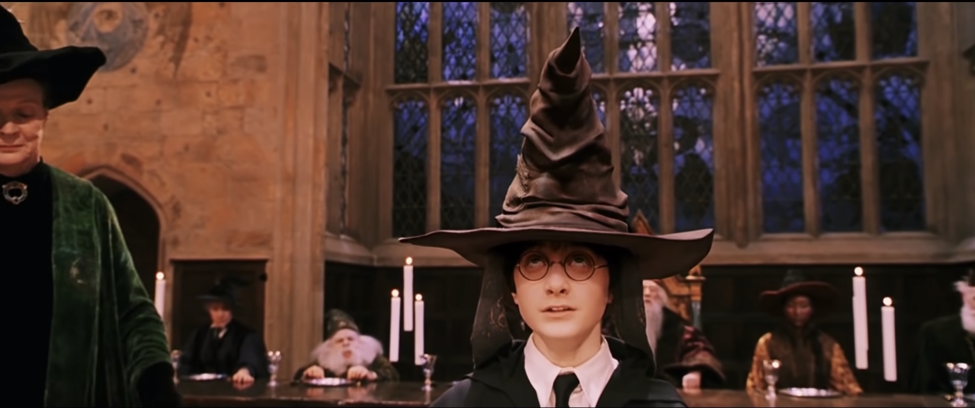 Harry Potter wears the sorting hat on his head