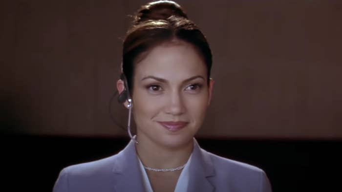 Jennifer Lopez smiles while wearing a headset as Mary