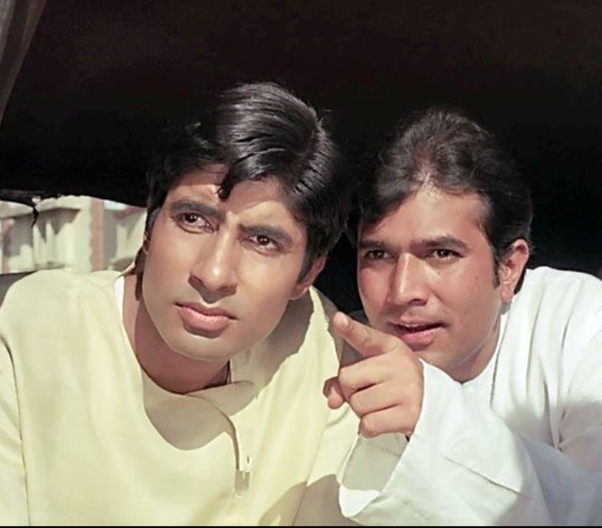 In a still from the movie Anand, Rajesh Khanna's Anand points at something while amitabh bachchan's dr bhaskar looks