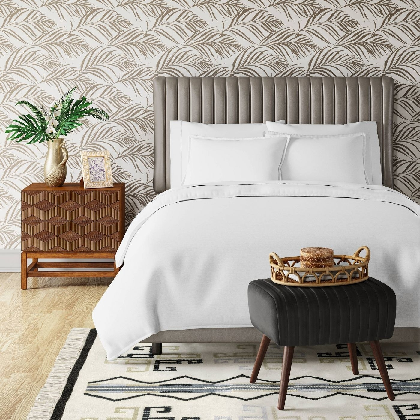 a staged bedroom with a velvet tufted headboard