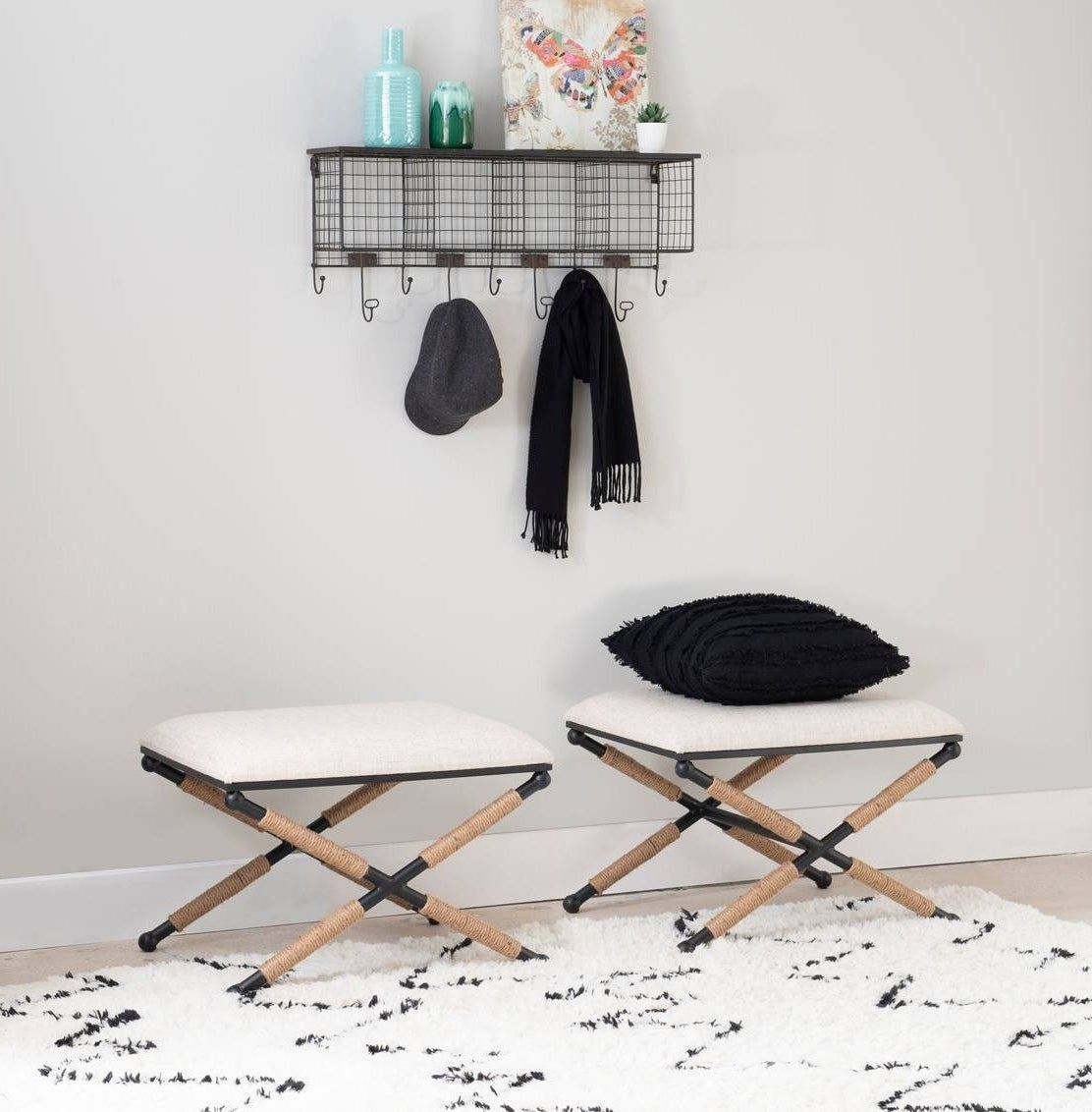 two foot stool with padded seats and rope wrapped legs