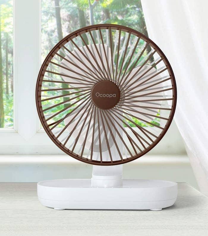 a cute fan in front of a window