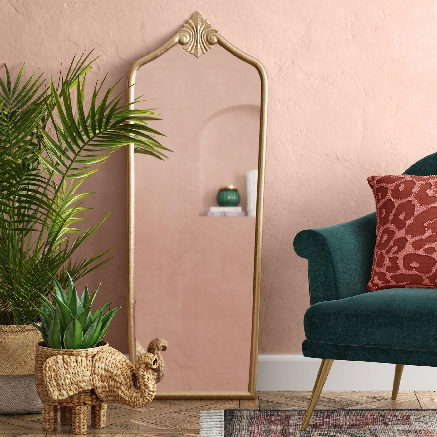 a rectangular gold floor mirror