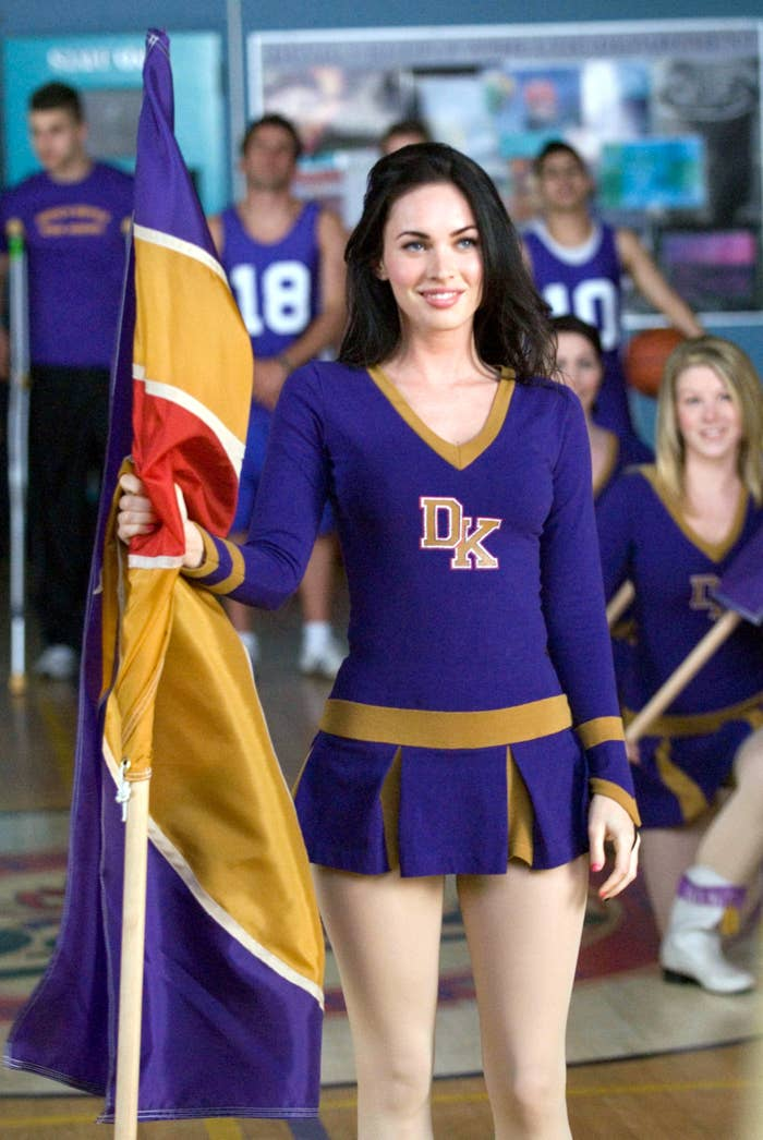 Megan in a cheerleader outfit