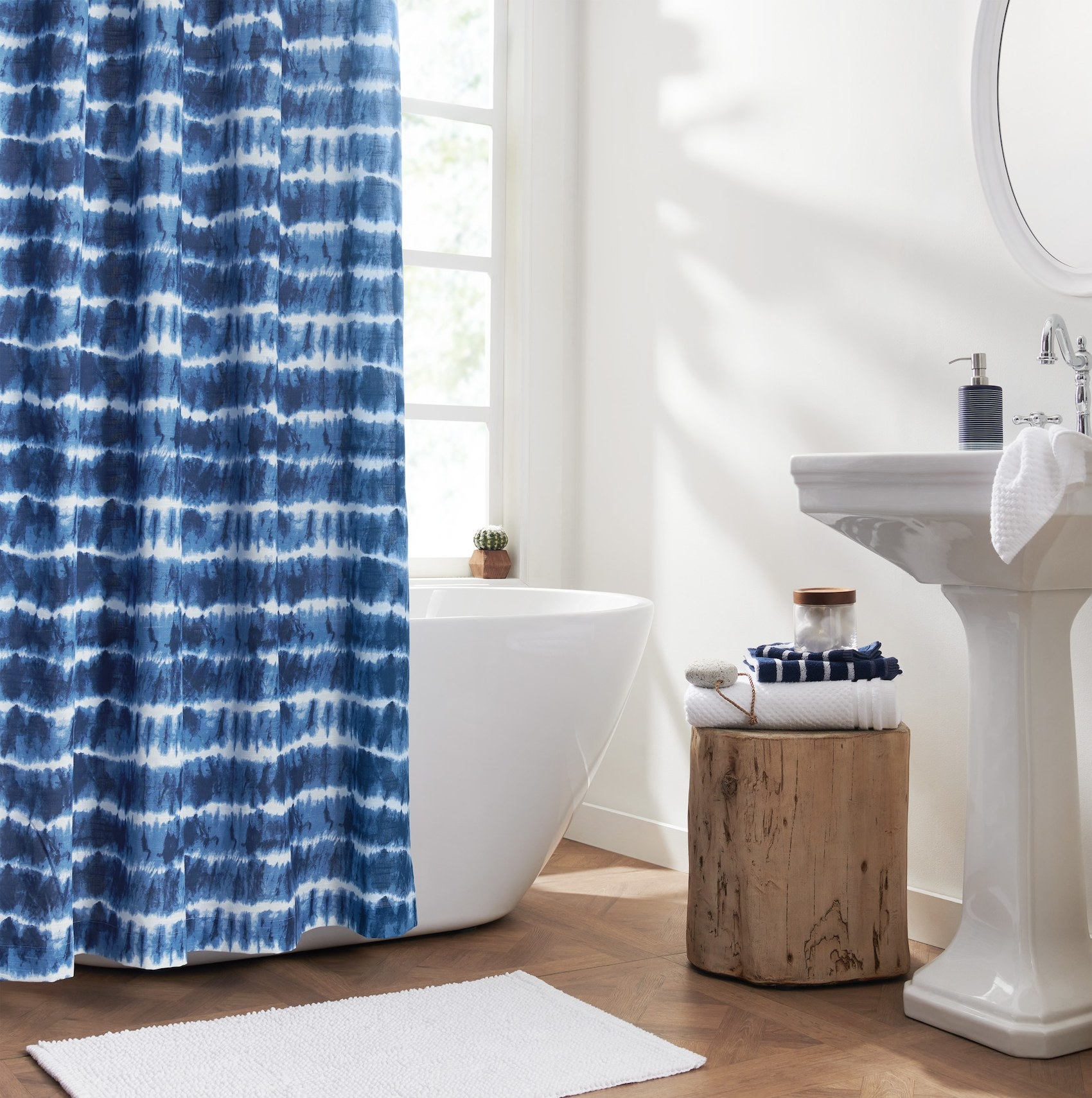 The blue and white tie dye shower curtain in a bathroom