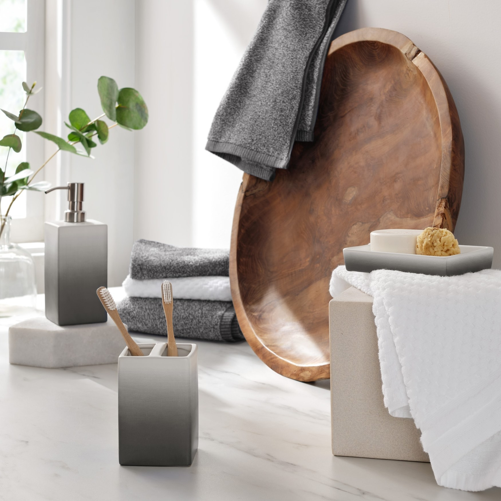 The gray ombre accessories set in a bathroom