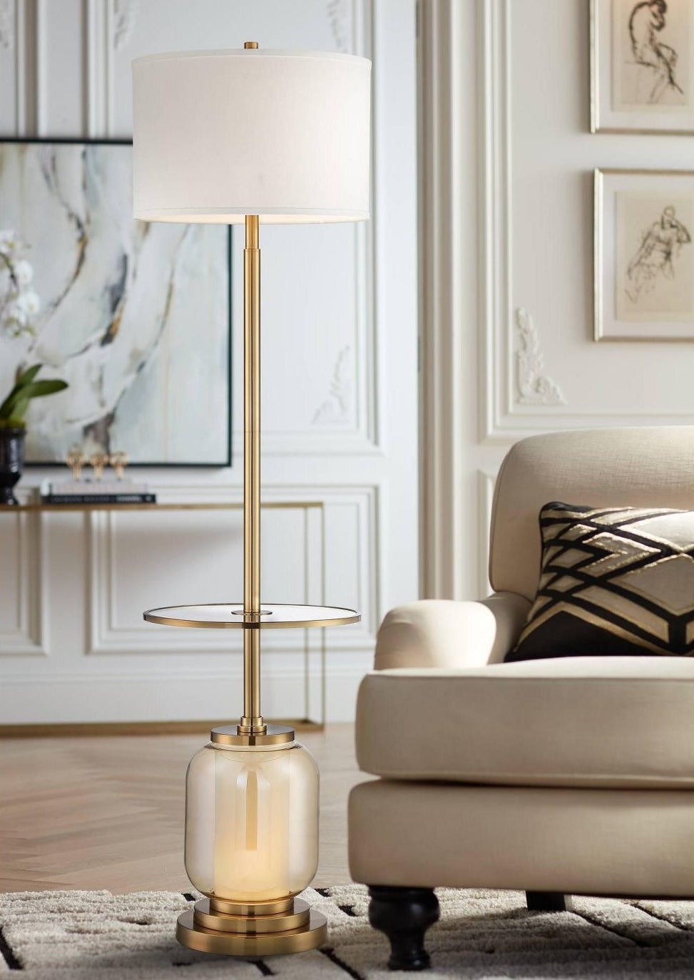 a floor lamp with a side table at the base