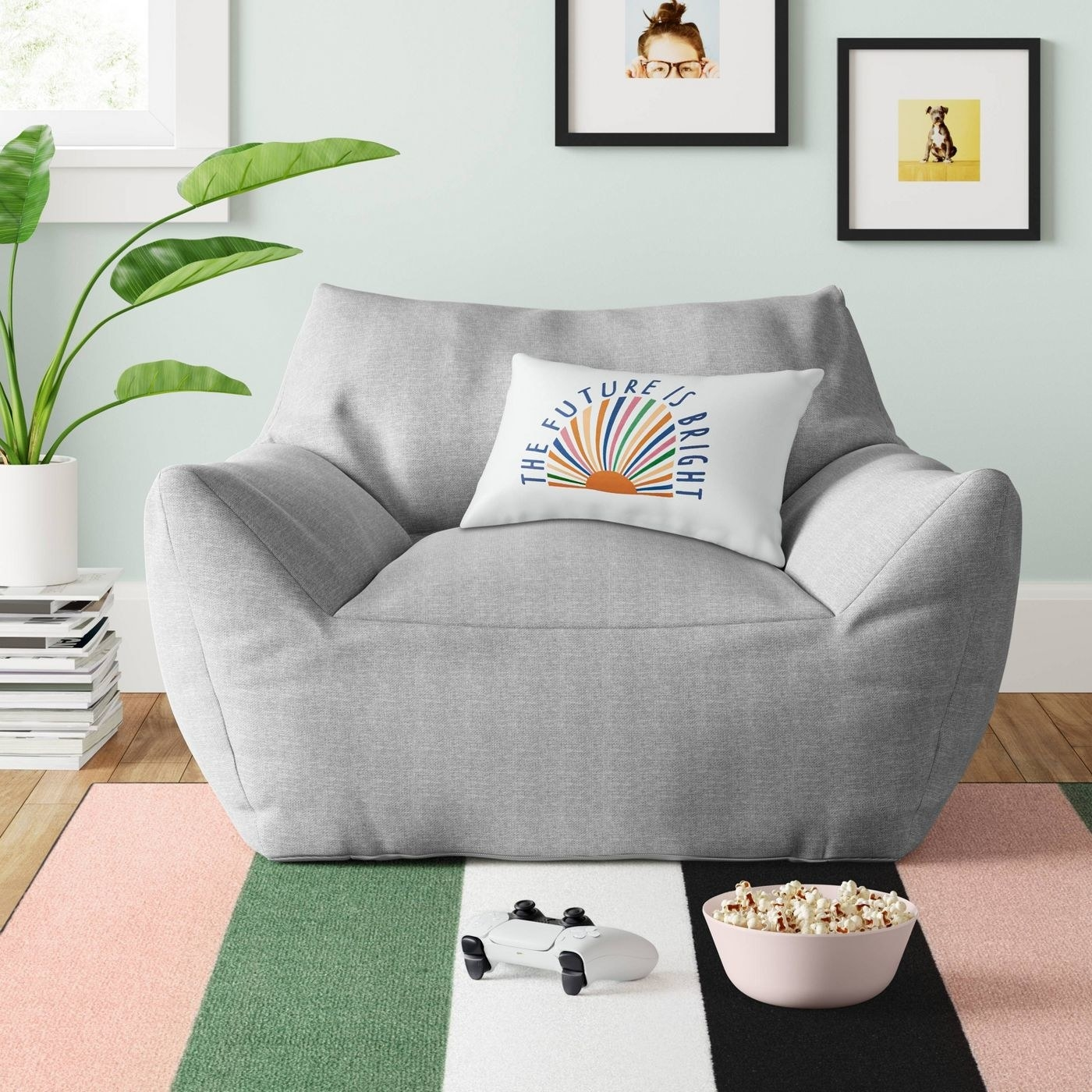 a grey bean bag chair with arms and a back