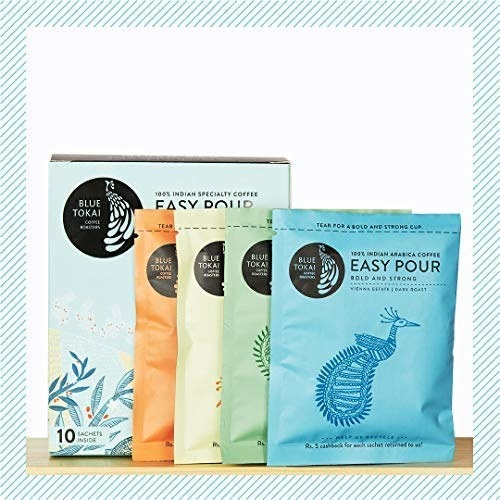 A set of easy pour sachets in front of the box of coffee