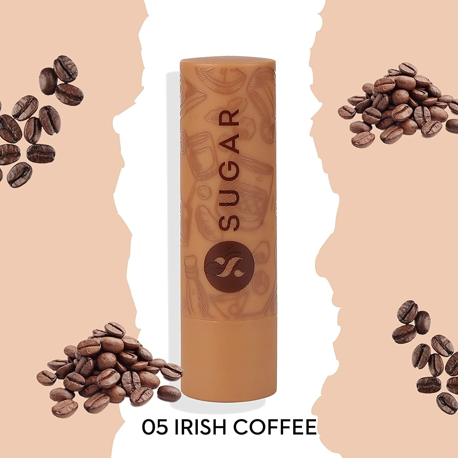 A coffee lip balm surrounded by coffee beans