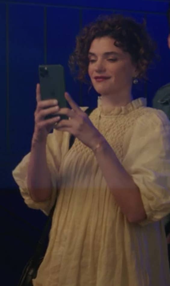 Wendy wears an oversize, light-colored flowy dress