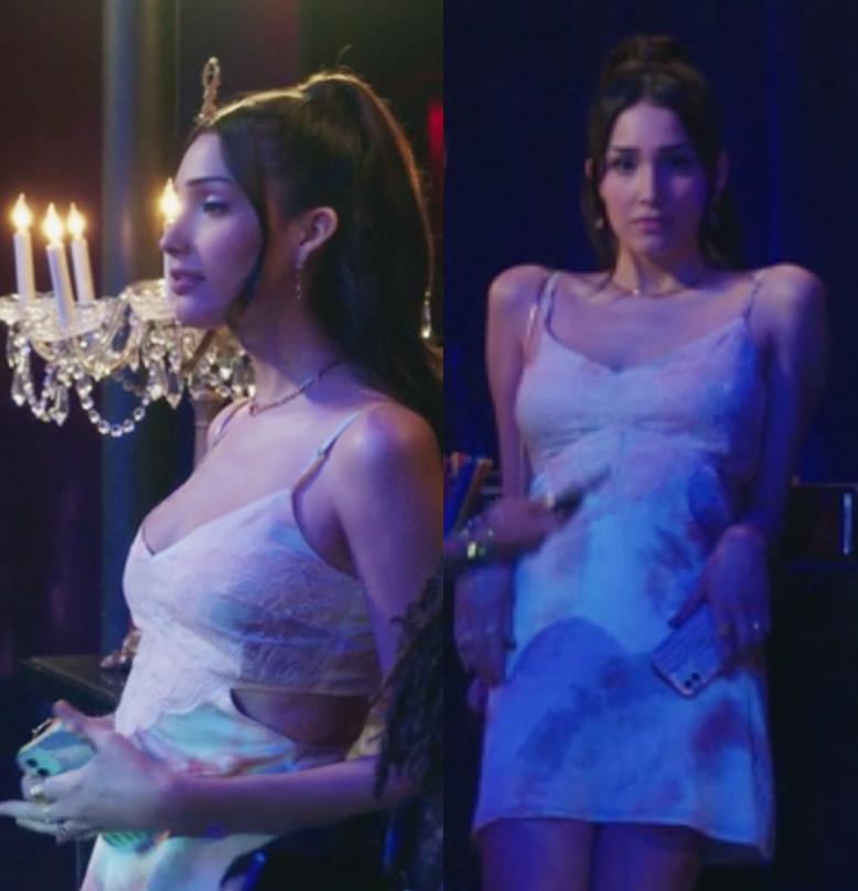 Luna wears a short lace tank top party dress