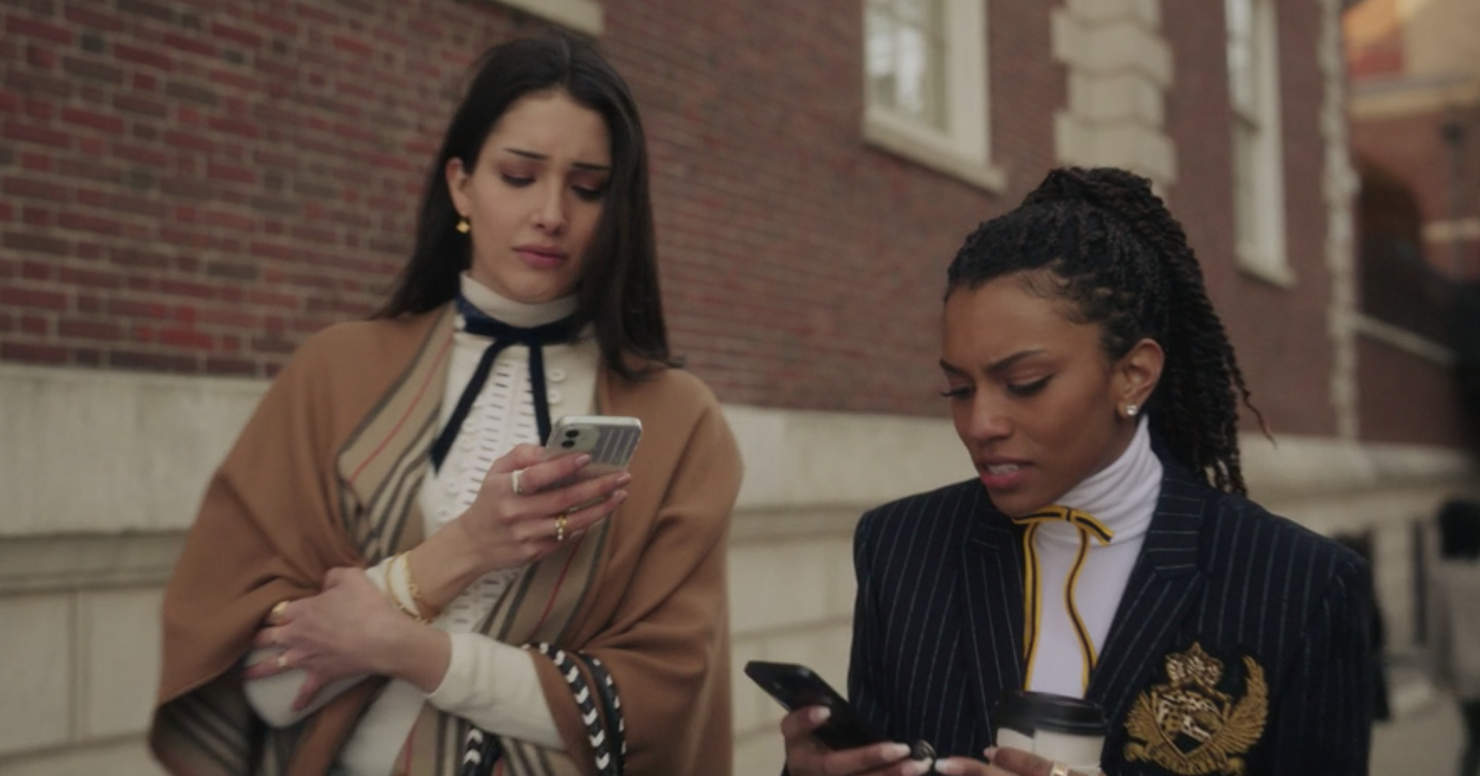 Luna wears a striped poncho over a ruffled shirt with a skinny bow tie, and Monet wears a pin-striped blazer over a turtleneck and a bright skinny bow tie