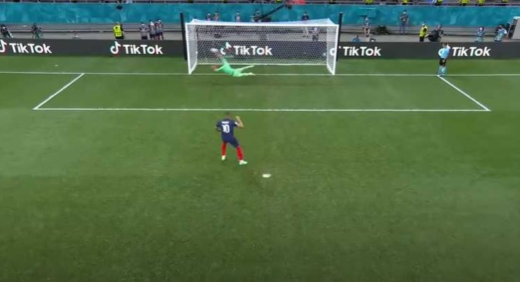 Goalie stretches out to make diving save on penalty kick