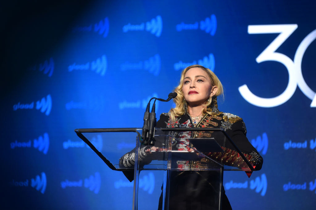 Madonna standing at the podium at a GLAAD event