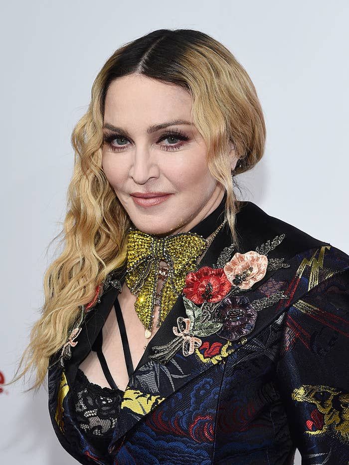 Madonna attends an event wearing an embroidered blazer with a floral brooch