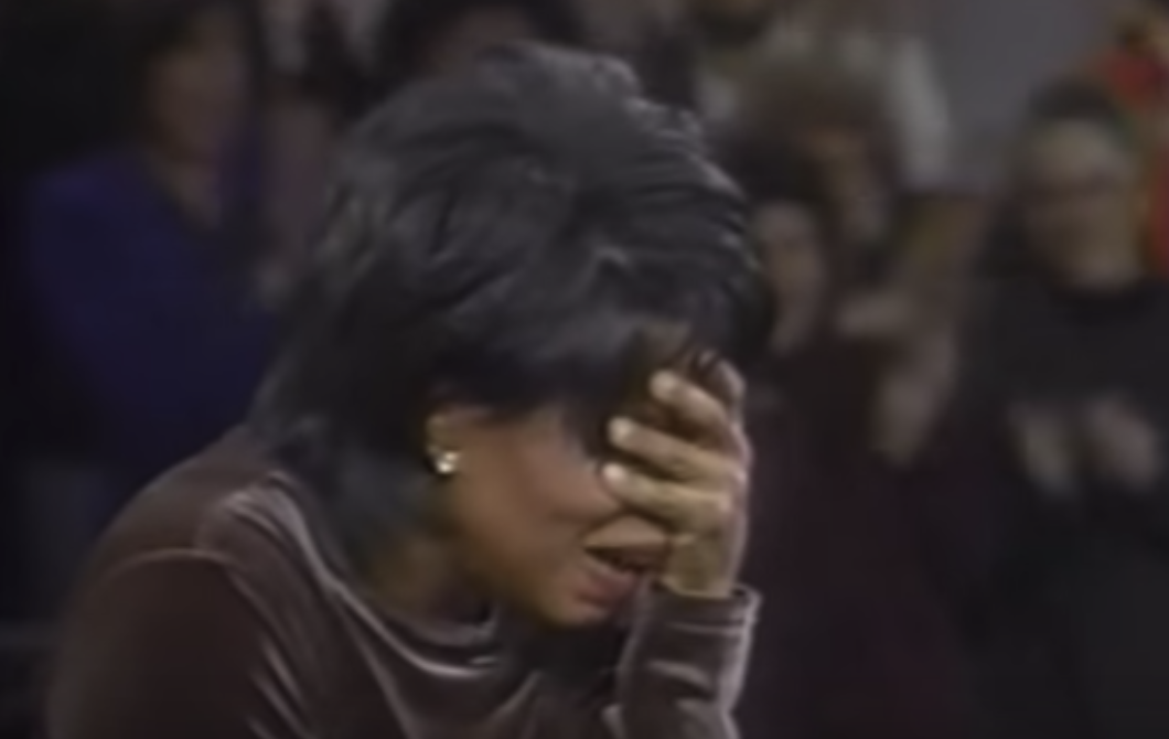 Oprah looking shocked with her hand over her eyes