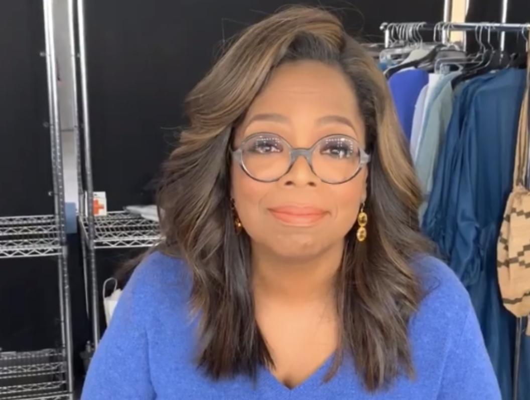 Oprah looking amused and wearing glasses