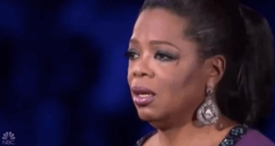 Oprah looking stunned and saddened