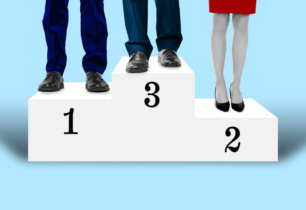 """Three sets of legs stand on a podium, the top labeled """"3,"""" the middle """"1,"""" and the bottom """"2"""""""