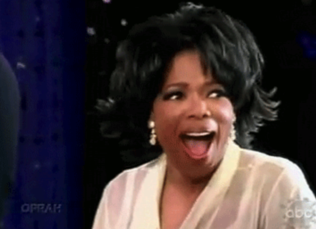 Oprah with her mouth wide open and looking amazed