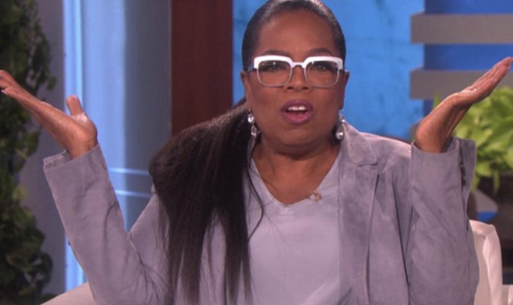 Oprah wearing glasses and looking mildly surprised