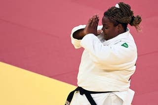 Two Brazilian athletes share a hug at the Olympics.
