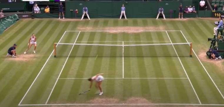 Woman hitting back a tennis shot
