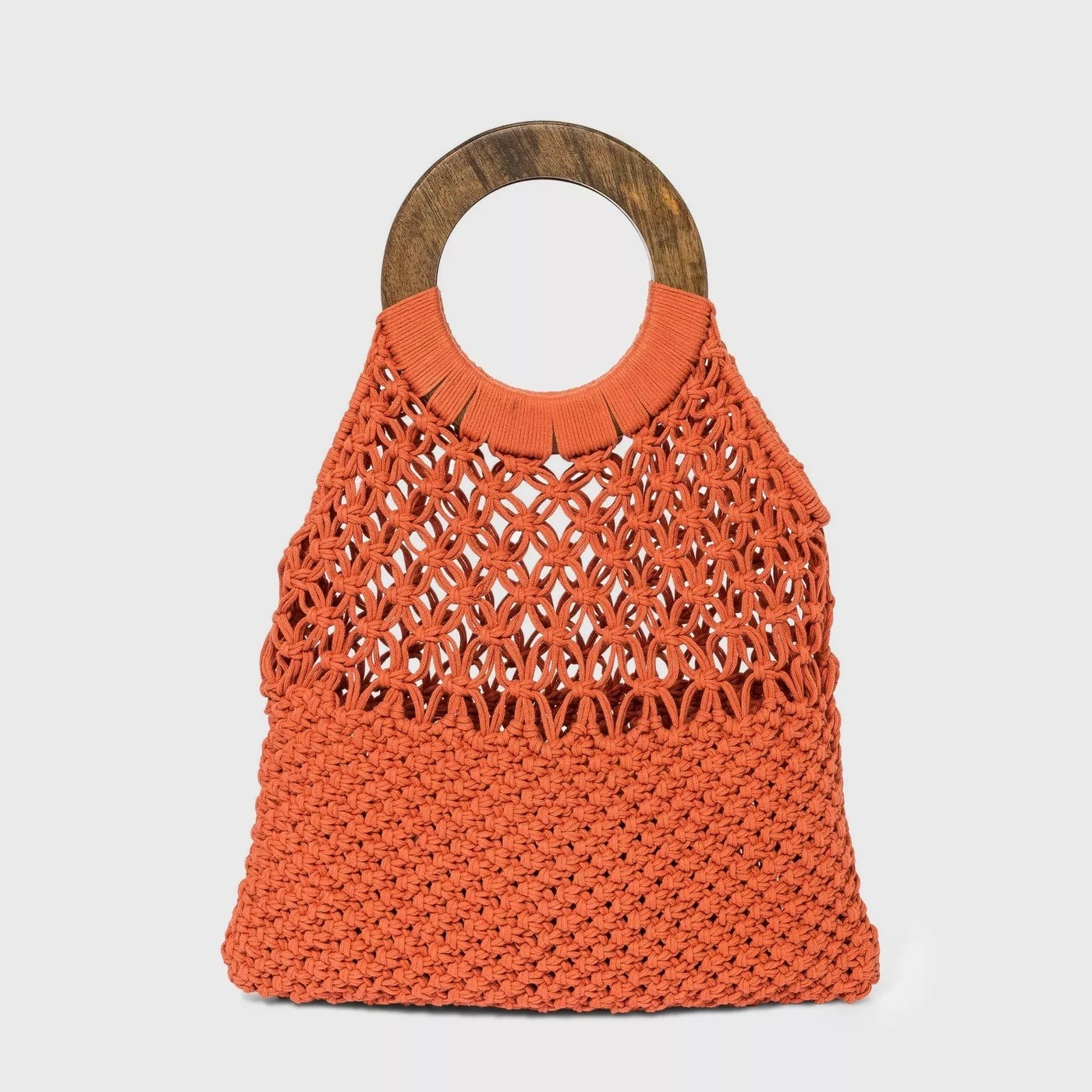 Orange purse with holes, and dark wooden handle