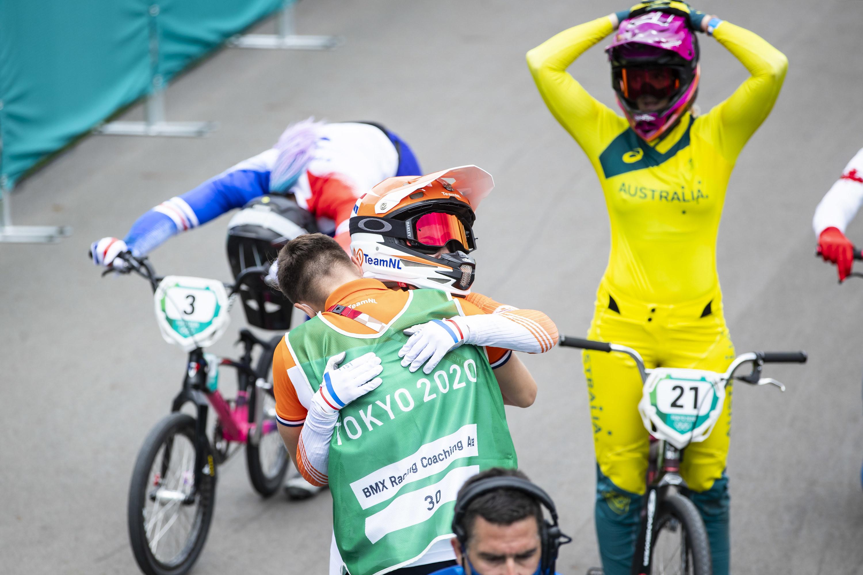 BMX rides hug after a race