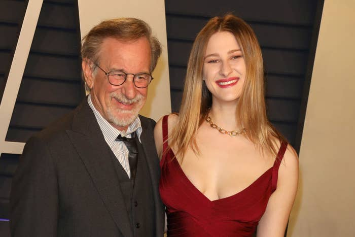 Stephen and Destry Spielberg smiling for photos at an event