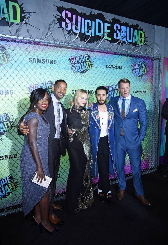 Viola Davis, Will Smith, Margot Robbie, Jared Leto, and Joel Kinnaman posing on the red carpet