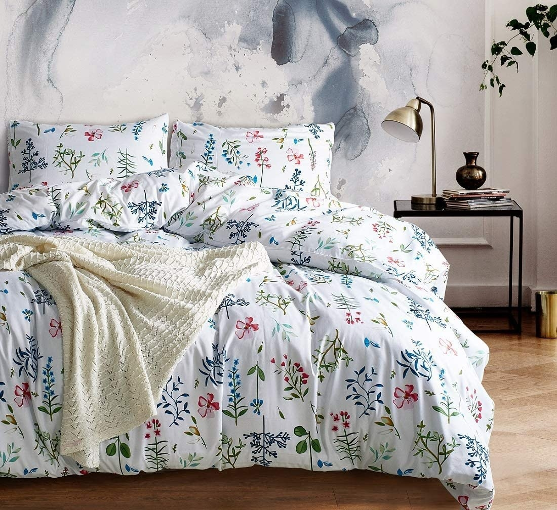 a floral bed set on a comfy bed in a relaxing room