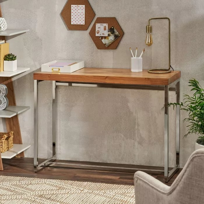The acacia wood desk with chrome legs