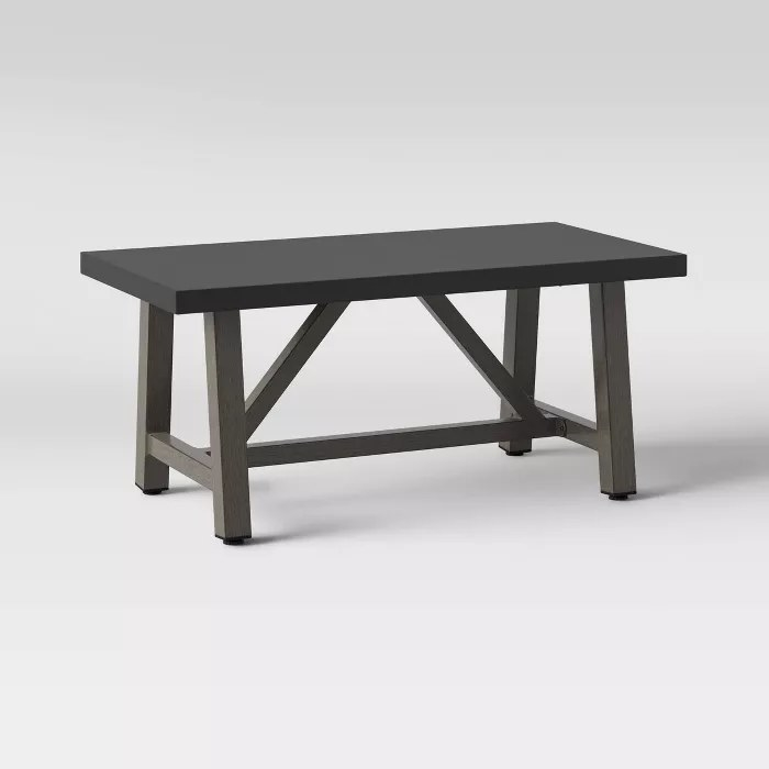 A faux concrete tabletop with a faux wood frame