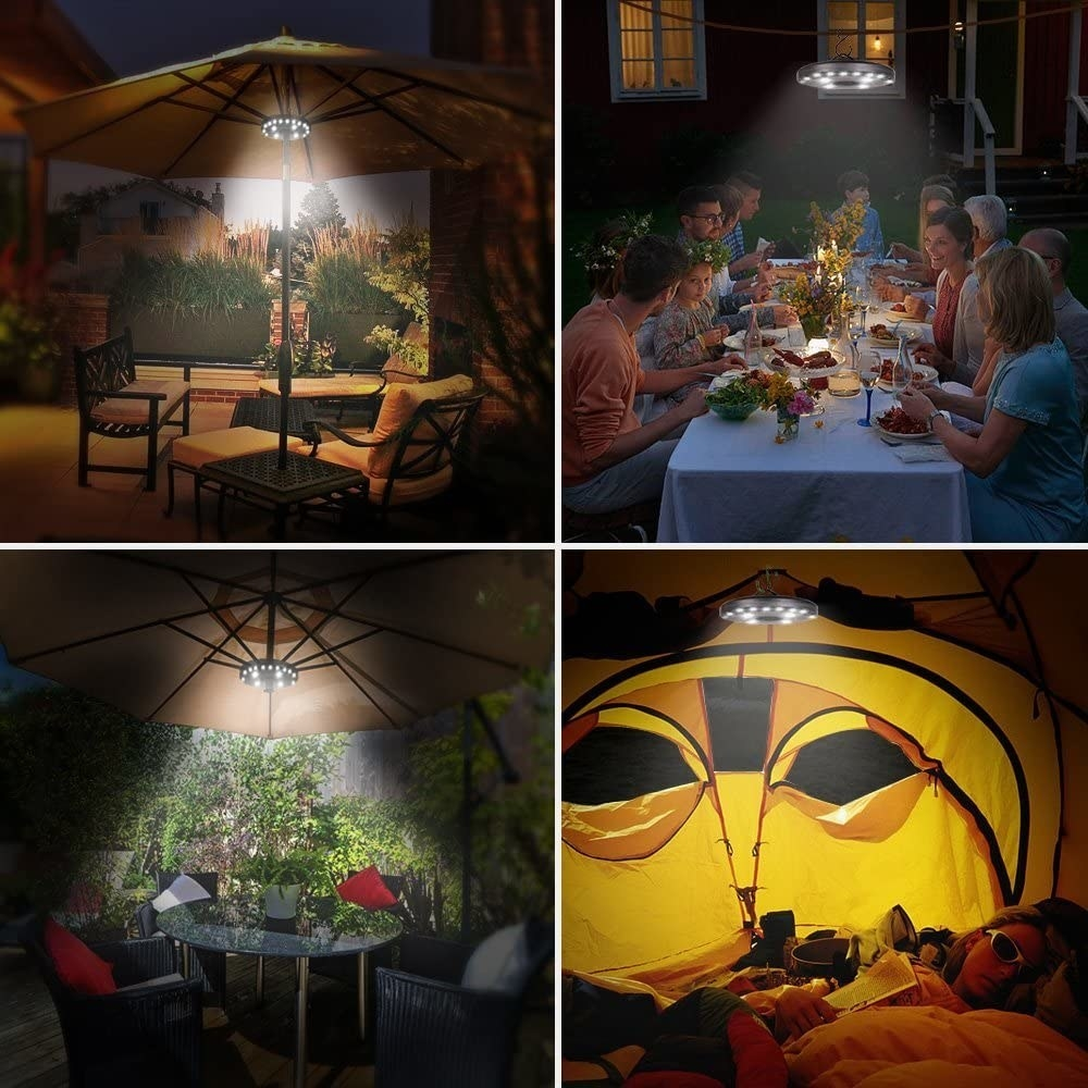 the umbrella light lighting up a patio tables and a tent