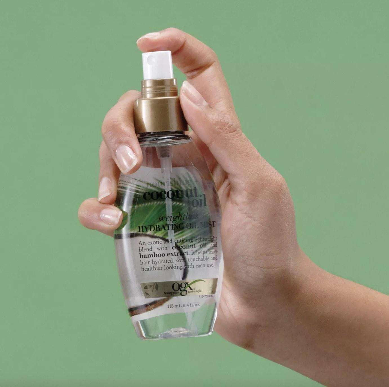 A bottle of hair oil mist