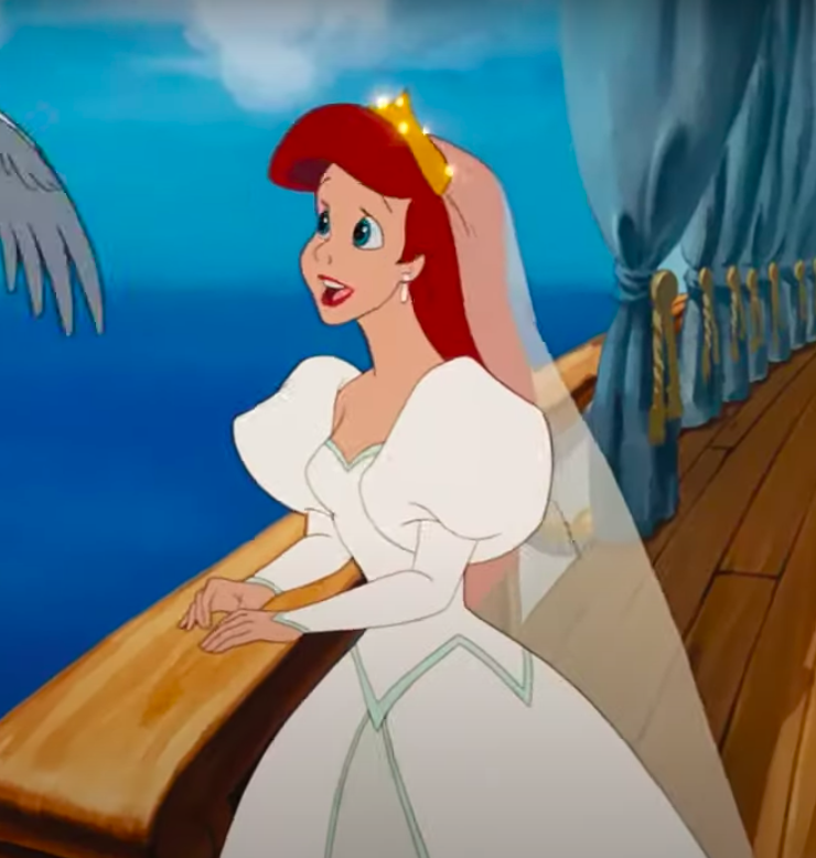 Ariel wearing a dress with big shoulders and then tight sleeves