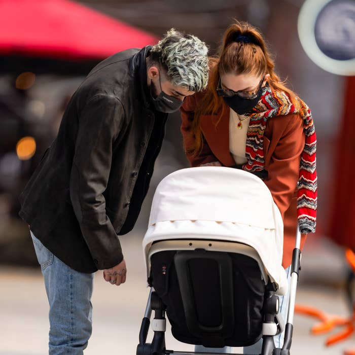 Zayn Malik and Gigi Hadid are seen walking daughter Khai in her stroller in NoHo on March 25, 2021, in New York City