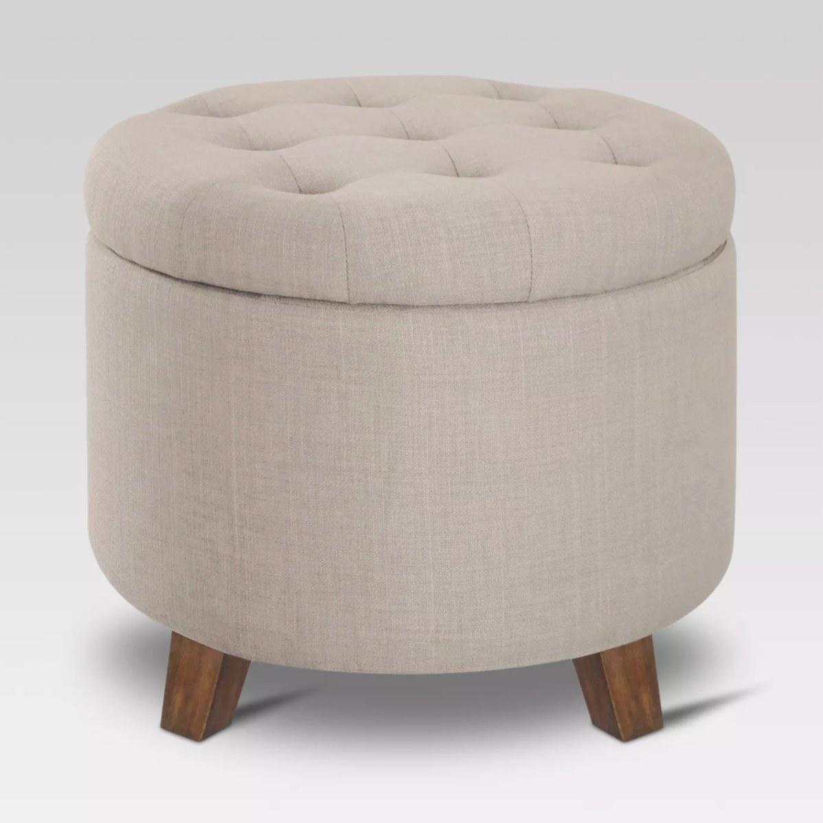 the round storage ottoman in cream