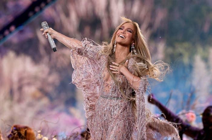 Jennifer Lopez looks elated on stage.